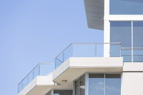 Closeup-modern-apartment-building-against-blue-sky,-copy-space-000075396623_Double.jpg