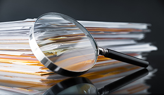 magnifying glass files linkedin website.jpg